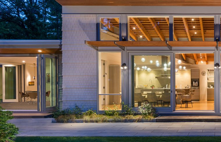 exterior of home at dusk with extended wood soffit cantilevered roof