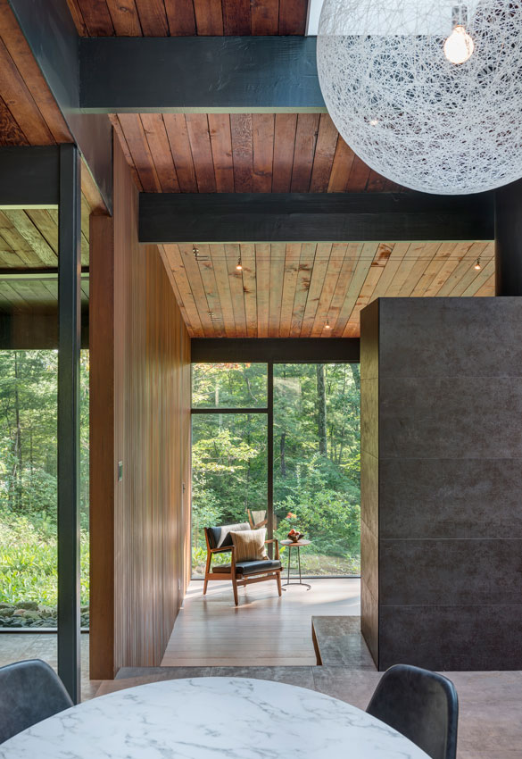 mid-century modern wood ceiling and floor to ceiling glass