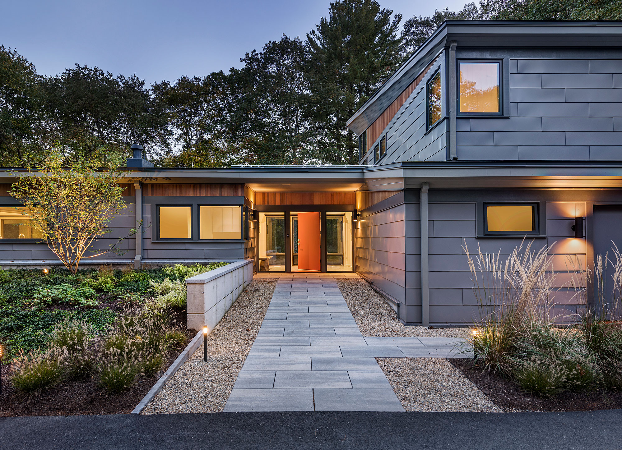 exterior home front entry with grey metal siding