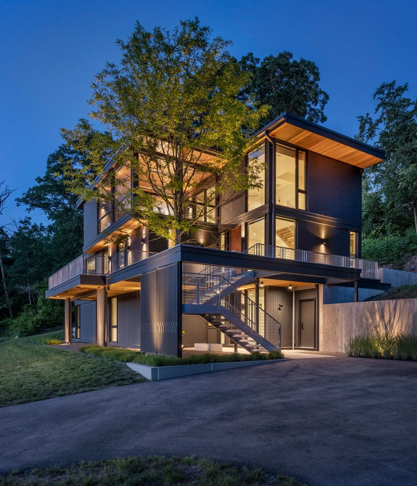 photo of exterior of annisquam river house at dusk
