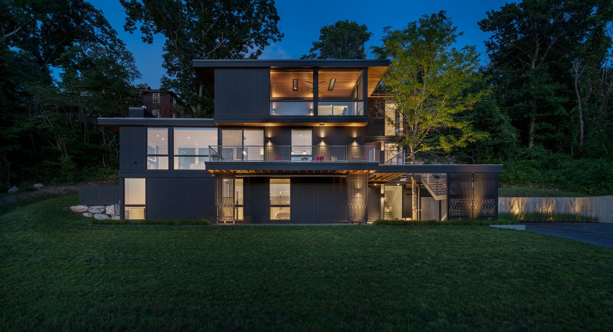 dusk photo of annisquam river house