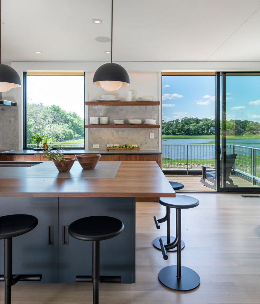 photo of kitchen looking outside in annisquam river house