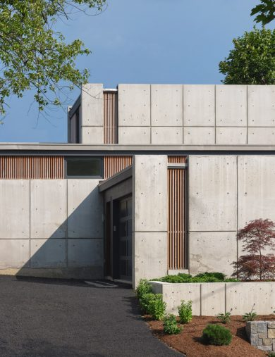 driveway entry of concrete home