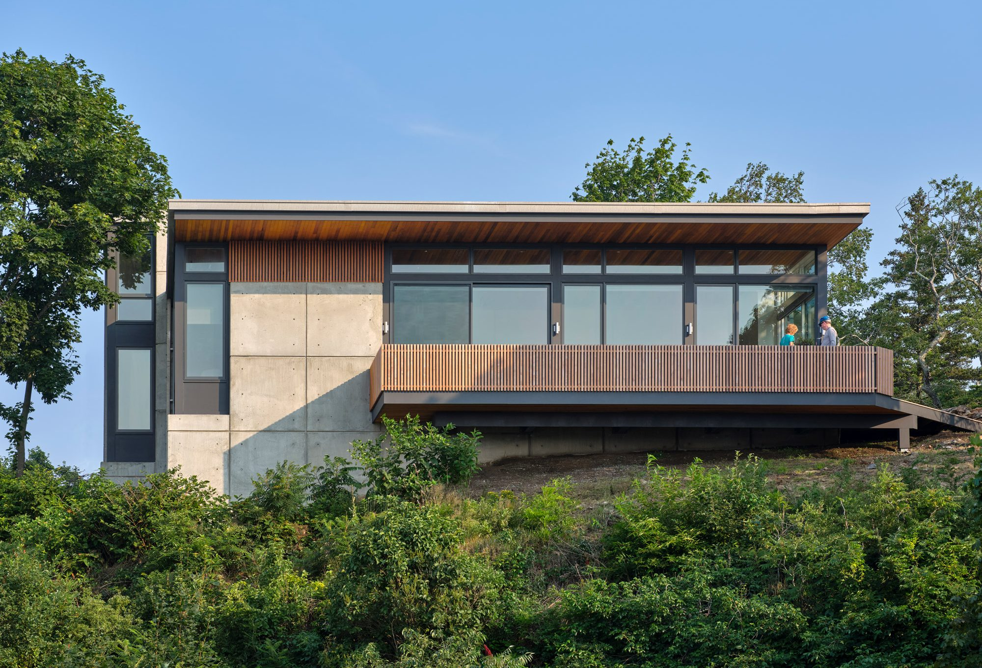 rear elevation of home with cantilevered deck
