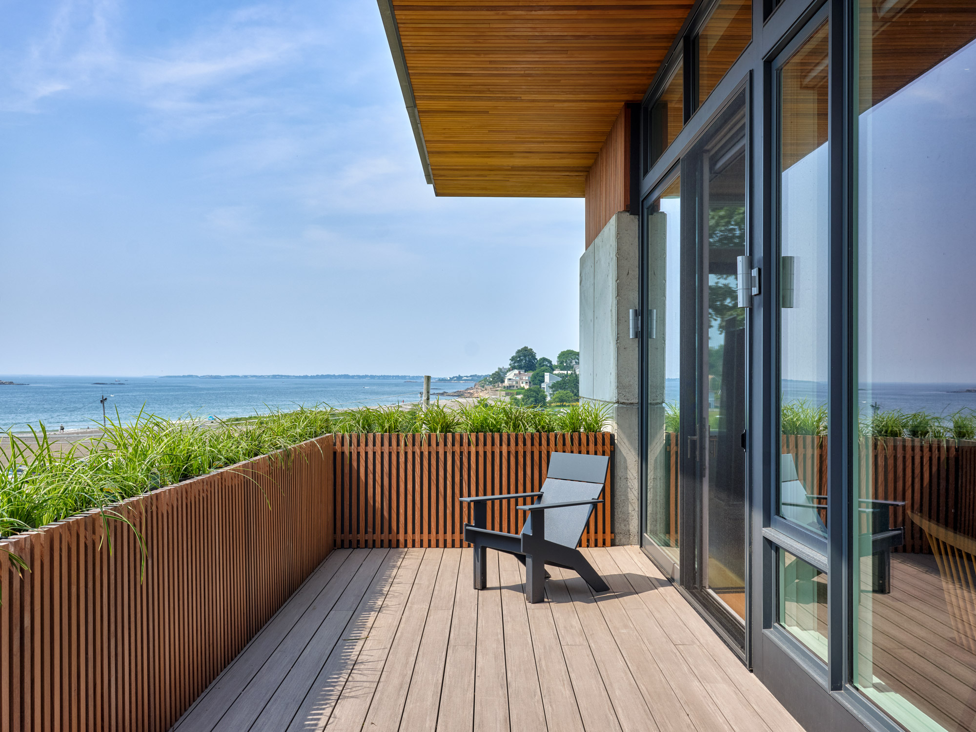 exterior deck with adirondack chair overlooking the ocean